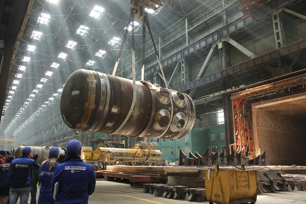 Reactor vessel for one of the two units under construction at Ostrovets being carried by overhead crane